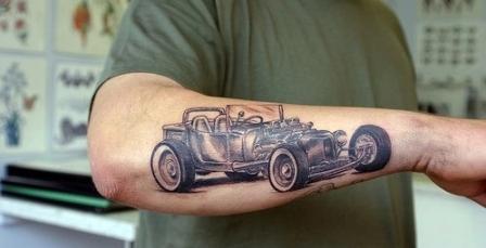 Car tattoo on arm